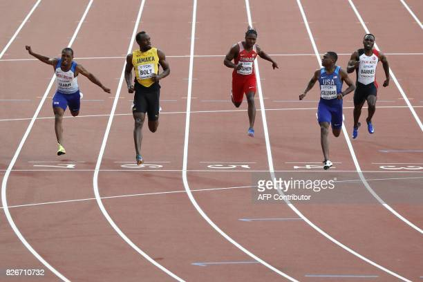 Jamaica's Usain Bolt and US athlete Christian Coleman look at each other in the semifinals of the men's 100m athletics event at the 2017 IAAF World...