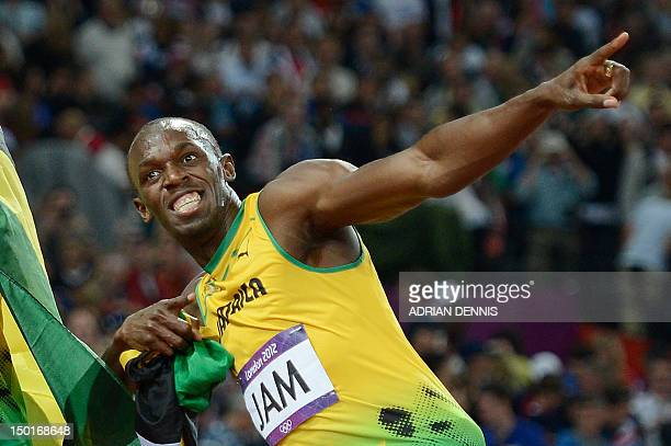Jamaica's Usain Bolt celebrates after Jamaica won and set a new world record in the men's 4X100 relay final at the athletics event of the London 2012...