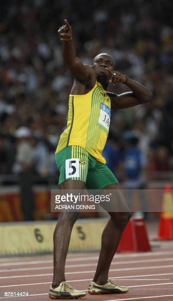 """Jamaica's Usain Bolt celebrates after winning the men's 4?100m relay final at the """"Bird's Nest"""" National Stadium during the 2008 Beijing Olympic..."""