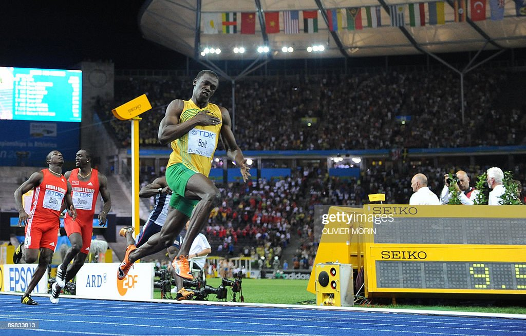 Jamaica's Usain Bolt celebrates winning the men's 100m final race of the 2009 IAAF Athletics World Championships ahead of US Tyson Gay and Jamaica's Asafa Powell on August 16, 2009 in Berlin. Jamaican Usain Bolt set a new world record of 9.58 seconds in winning the final of the men's 100m at the World Athletics Championships. His time bettered his own world record of 9.69sec set in the Beijing Olympics final.