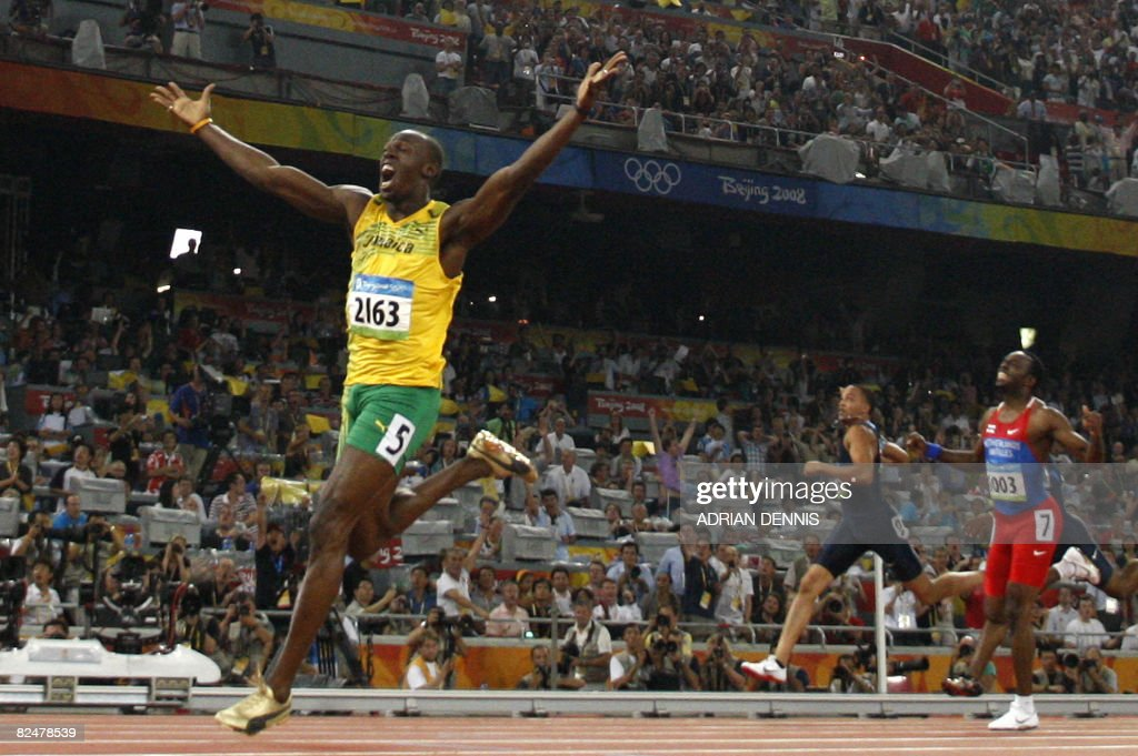 Jamaica's Usain Bolt celebrates winning the men's 200m final at the National stadium as part of the 2008 Beijing Olympic Games on August 20, 2008. Bolt broke the men's 200 metres world record here on Wednesday timing 19.30 seconds as he clinched the Olympic Games gold to add to his 100m crown.