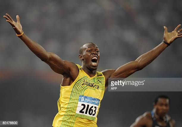 """Jamaica's Usain Bolt celebrates winning the men's 200m final at the """"Bird's Nest"""" National Stadium during the 2008 Beijing Olympic Games on August..."""