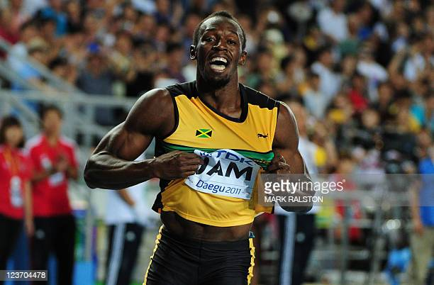 Jamaica's Usain Bolt celebrates winning the men's 4x100 metres relay final to set a new world record at the International Association of Athletics...
