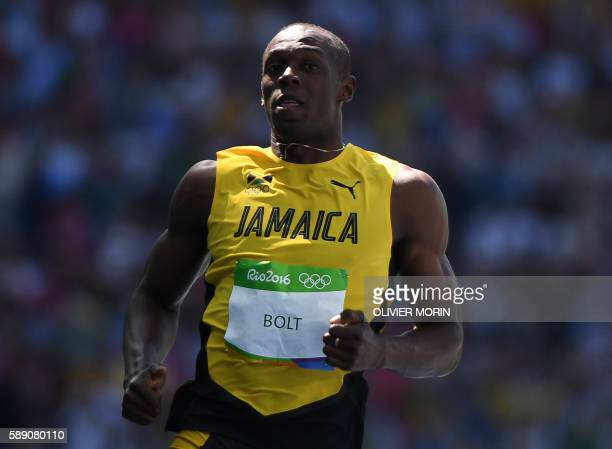 Jamaica's Usain Bolt competes in the Men's 100m Round 1 during the athletics event at the Rio 2016 Olympic Games at the Olympic Stadium in Rio de...