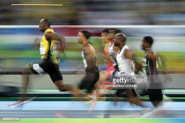 TOPSHOT Jamaica's Usain Bolt competes in the Men's 100m Semifinal during the athletics event at the Rio 2016 Olympic Games at the Olympic Stadium in...