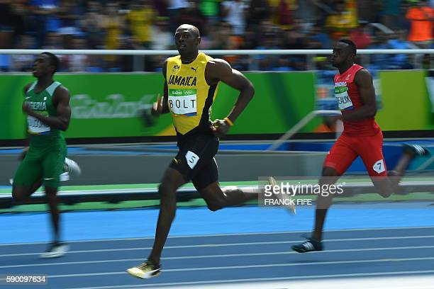 Jamaica's Usain Bolt competes in the Men's 200m Round 1 during the athletics competition at the Rio 2016 Olympic Games at the Olympic Stadium in Rio...