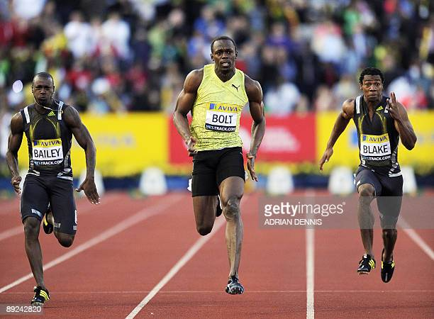 Jamaica's Usain Bolt competes to win the Men's 100 metres with Yohan Blake of Jamaica and Daniel Bailey of Antigua during the first day of the London...