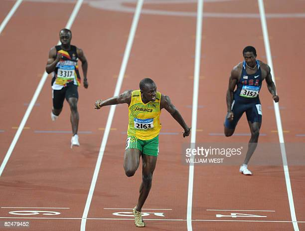 Jamaica's Usain Bolt crosses the finish line ahead of Shawn Crawford of the US to win the men's 200m final at the National stadium as part of the...