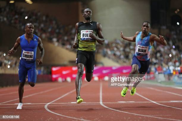 TOPSHOT Jamaica's Usain Bolt crosses the finish line to win the men's 100m event at the IAAF Diamond League athletics meeting in Monaco on July 21...