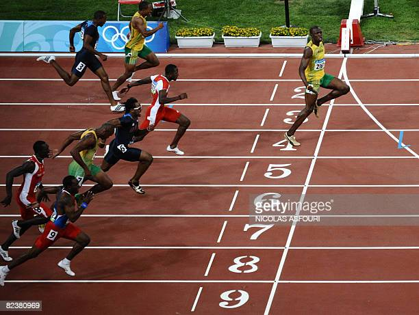 Jamaica's Usain Bolt crosses the finish line to win the men's 100m final at the National stadium as part of the 2008 Beijing Olympic Games on August...