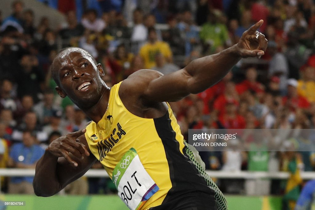 Jamaica's Usain Bolt does his 'Lightening Bolt' pose after he won the Men's 200m Final during the athletics event at the Rio 2016 Olympic Games at the Olympic Stadium in Rio de Janeiro on August 18, 2016. / AFP PHOTO / Adrian DENNIS