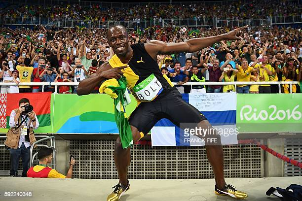 TOPSHOT Jamaica's Usain Bolt does his 'Lightening Bolt' pose after Team Jamaica won the Men's 4x100m Relay Final during the athletics event at the...