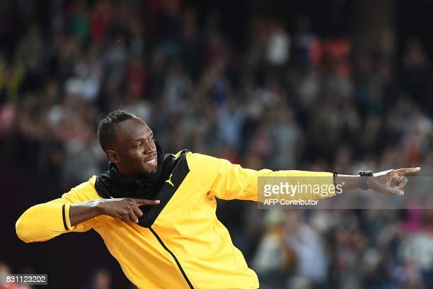 Jamaica's Usain Bolt does his trademark gesture as he takes part in a lap of honour on the final day of the 2017 IAAF World Championships at the...