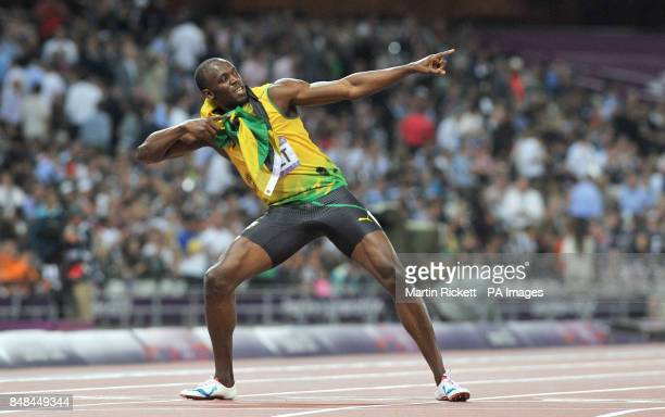 Jamaica's Usain Bolt does his trademark 'Lightening Bolt' after winning the gold medal in the Men's 200m final at the Olympic Stadium London