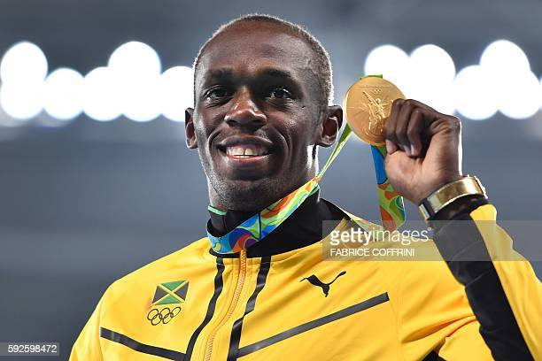Jamaica's Usain Bolt holds his gold medal during the podium ceremony for the Men's 200m during the athletics event at the Rio 2016 Olympic Games at...