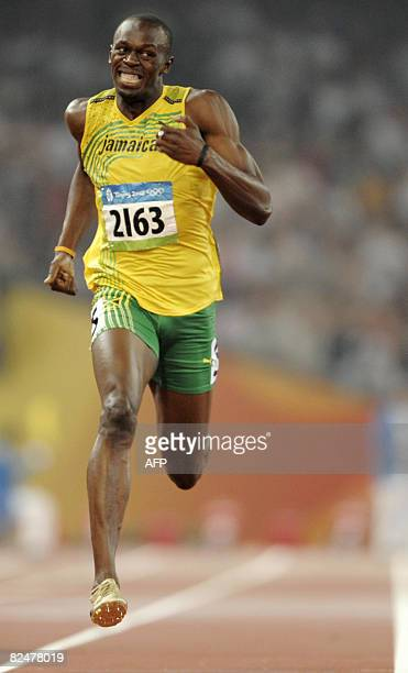Jamaica's Usain Bolt jubilates as he crosses the finishline to win the men's 200m final at the 'Bird's Nest' National Stadium during the 2008 Beijing...