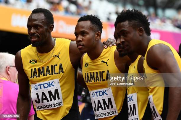Jamaica's Usain Bolt Julian Forte Michael Campbell and Tyquendo Tracey pose after winning their heat of the men's 4x100m relay athletics event at the...