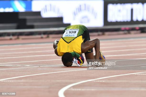 TOPSHOT Jamaica's Usain Bolt kisses the track after taking bronze in the final of the men's 100m athletics event at the 2017 IAAF World Championships...