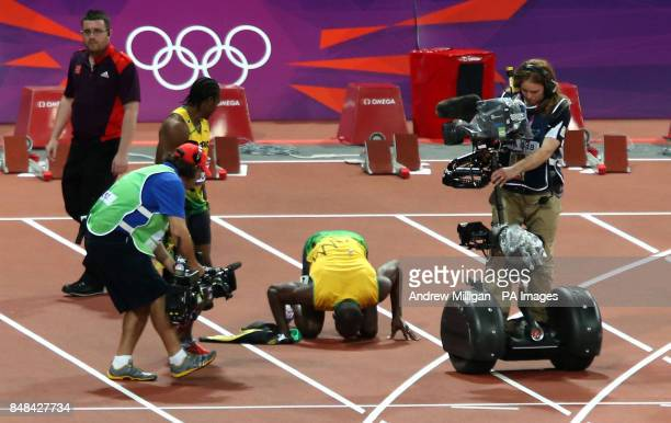 Jamaica's Usain Bolt kisses the track as he celebrates winning the Men's 100m Final at the Olympic Stadium on day nine of the London 2012 Olympic...