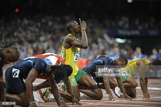 Jamaica's Usain Bolt makes a sign prior to take the start of the men's 100m final at the National stadium as part of the 2008 Beijing Olympic Games...