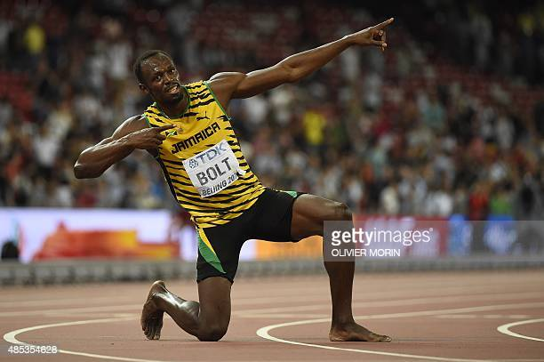 Jamaica's Usain Bolt makes his trademark celebration pose after winning the final of the men's 200 metres athletics event at the 2015 IAAF World...