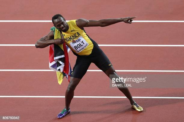 Jamaica's Usain Bolt poses after taking bronze in the final of the men's 100m athletics event at the 2017 IAAF World Championships at the London...