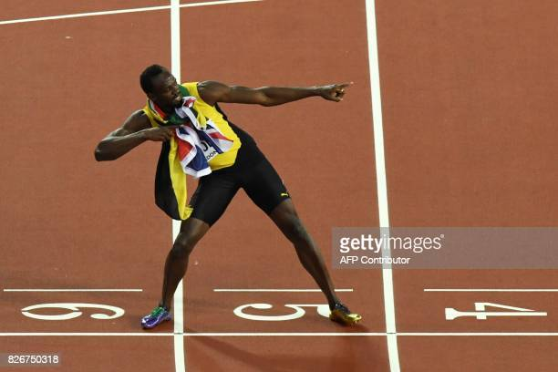 Jamaica's Usain Bolt poses after taking the third place in the men's 100m athletics event at the 2017 IAAF World Championships at the London Stadium...