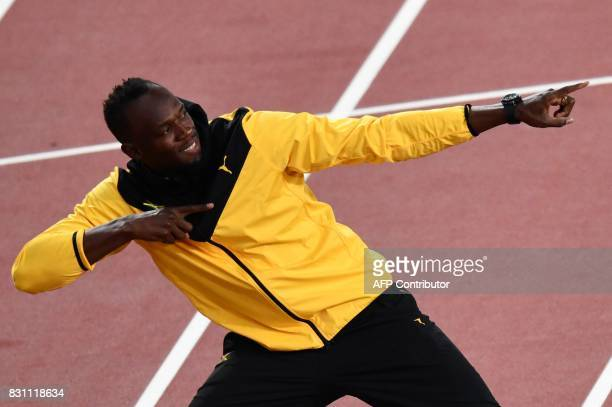 Jamaica's Usain Bolt poses as he takes part in a lap of honour on the final day of the 2017 IAAF World Championships at the London Stadium in London...