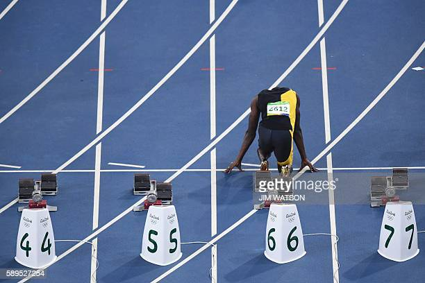 TOPSHOT Jamaica's Usain Bolt prepares to compete in the Men's 100m final during the athletics event at the Rio 2016 Olympic Games at the Olympic...