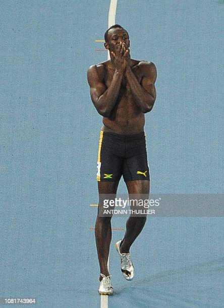 Jamaica's Usain Bolt reacts after a false start in the men's 100 metres final at the International Association of Athletics Federations World...