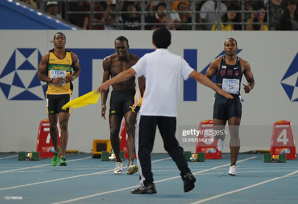Jamaica's Usain Bolt (2L) reacts after making a false start in the final of the men's 100 metres at The International Association of Athletics Federations (IAAF) World Championships in Daegu on August 28, 2011. Usain Bolt, the world's fastest man, had barely left the track after his astonishing false start in the world championships 100m final before a debate swirled over the controversial rule. A packed stadium was stunned into silence in the seconds after the preening sprint star shot too early from his blocks on August 28, as, distraught, he tore off his shirt and held his head in disbelief. The Jamaican defending world champion and world record holder was a victim of a rule in effect since January 1, 2010, meaning immediate disqualification for a false start.