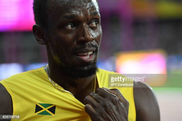 Jamaica's Usain Bolt reacts after placing third in the final of the men's 100m athletics event at the 2017 IAAF World Championships at the London...