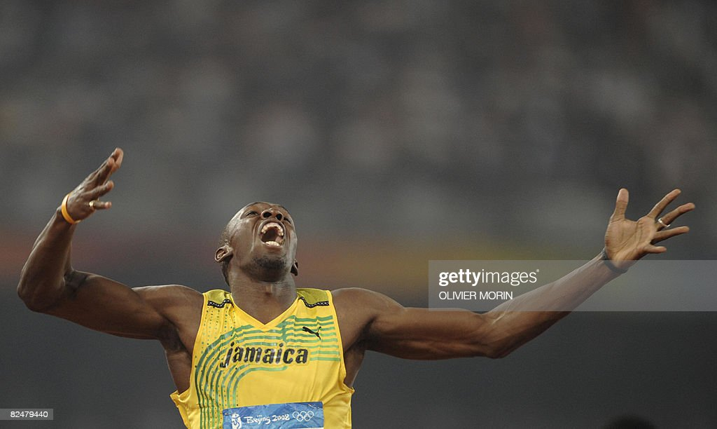 Jamaica's Usain Bolt reacts after winning the men's 200m final at the 'Bird's Nest' National Stadium during the 2008 Beijing Olympic Games on August 20, 2008. Bolt broke the men's 200m world record, timing 19.30 seconds as he clinched the Olympic Games gold to add to his 100m crown.