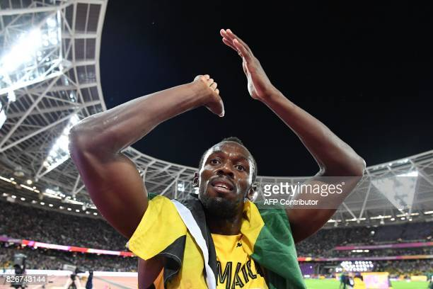 Jamaica's Usain Bolt receives applause after placing third in the men's 100m athletics event at the 2017 IAAF World Championships at the London...