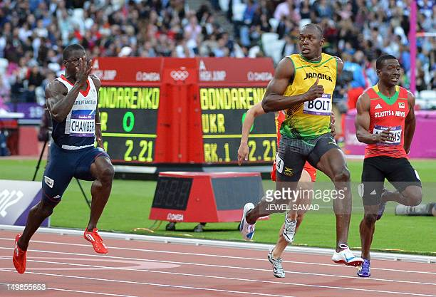 Jamaica's Usain Bolt Saint Kitts Nevis' Antoine Adams and Britain's Dwain Chambers compete in the men's 100m semifinals at the athletics event during...