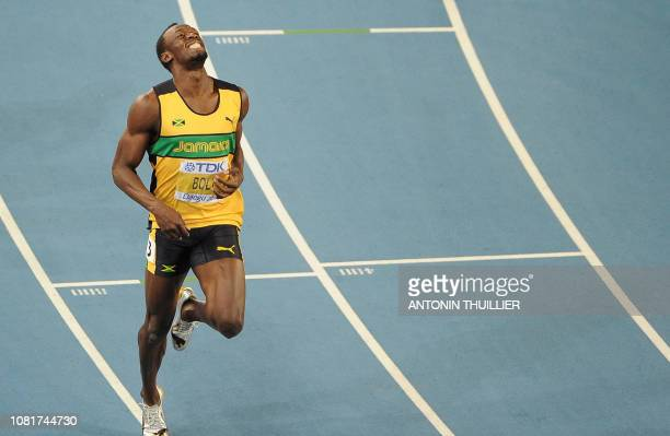Jamaica's Usain Bolt smiles after crossing the finish line to win gold in the men's 200 metres final at the International Association of Athletics...