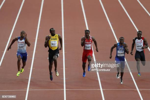 Jamaica's Usain Bolt watches US athlete Christian Coleman during the semifinals of the men's 100m athletics event at the 2017 IAAF World...