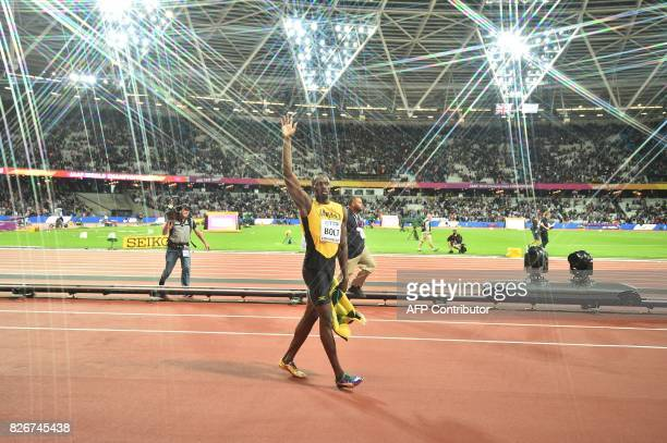 Jamaica's Usain Bolt waves to the crowd after taking bronze in the final of the men's 100m athletics event at the 2017 IAAF World Championships at...