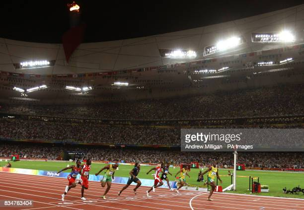 Jamaica's Usain Bolt wins the gold medal and breaks the world record during the men's 100m final at the National Stadium during the 2008 Beijing...