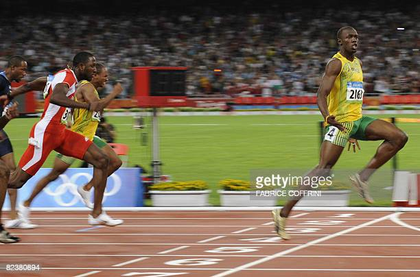 Jamaica's Usain Bolt wins the men's 100m final at the National stadium as part of the 2008 Beijing Olympic Games on August 16 2008 AFP PHOTO /...