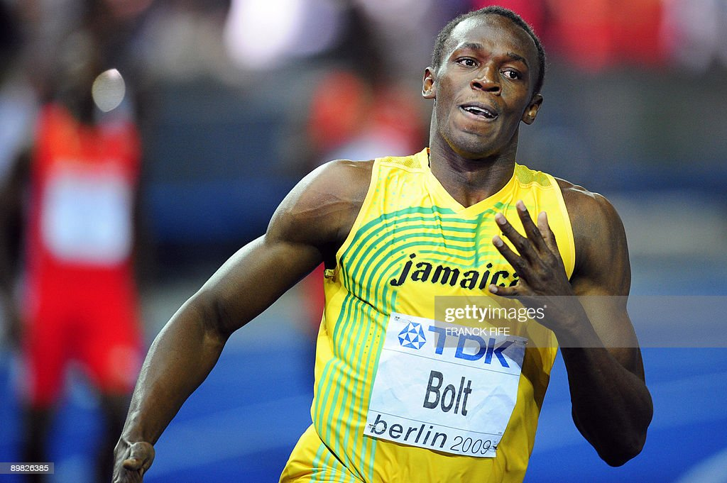 Jamaica's Usain Bolt wins the men's 100m final race of the 2009 IAAF Athletics World Championships ahead of US Tyson Gay and Jamaica's Asafa Powell on August 16, 2009 in Berlin. Jamaican Usain Bolt set a new world record of 9.58 seconds in winning the final of the men's 100m at the World Athletics Championships. His time bettered his own world record of 9.69sec set in the Beijing Olympics final.
