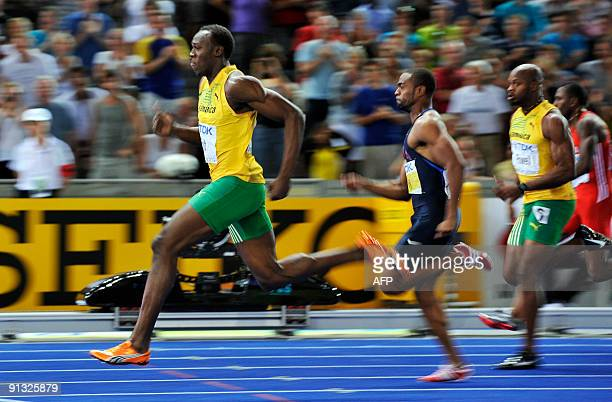 Jamaica's Usain Bolt wins the men's 100m final race of the 2009 IAAF Athletics World Championships ahead of US Tyson Gay and Jamaica's Asafa Powell...