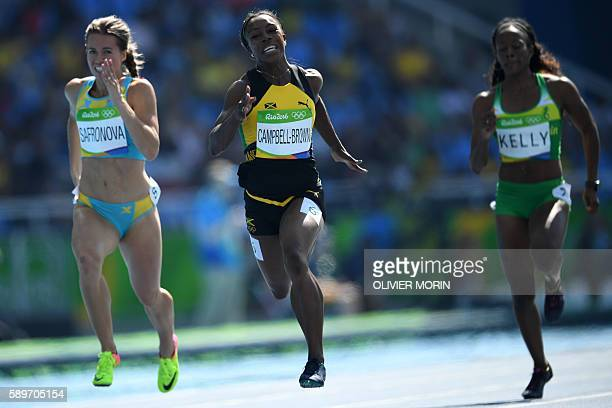 Jamaica's Veronica CampbellBrown competes with Kazakhstan's Olga Safronova and British Virgin Islands's Ashley Kelly in the Women's 200m Round 1...