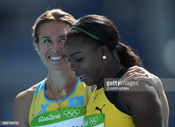 Jamaica's Veronica CampbellBrown is congratulated by Kazakhstan's Olga Safronova after competing in the Women's 200m Round 1 during the athletics...