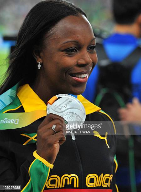 Jamaica's Veronica CampbellBrown poses on the podium with her silver medal during the medal ceremony for the Women's 100m final at the International...
