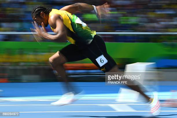 TOPSHOT Jamaica's Yohan Blake competes in the Men's 200m Round 1 during the athletics competition at the Rio 2016 Olympic Games at the Olympic...