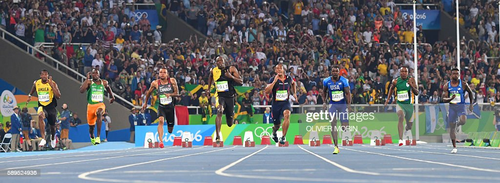 TOPSHOT - (FromL) Jamaica's Yohan Blake, Ivory Coast's Ben Youssef Meite, Canada's Andre De Grasse, Jamaica's Usain Bolt, France's Jimmy Vicaut, USA's Justin Gatlin, South Africa's Akani Simbine and USA's Trayvon Bromell compete in the Men's 100m Final during the athletics event at the Rio 2016 Olympic Games at the Olympic Stadium in Rio de Janeiro on August 14, 2016. / AFP / OLIVIER