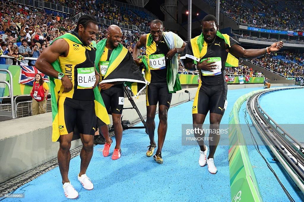 TOPSHOT - (FromL) Jamaica's Yohan Blake, Jamaica's Asafa Powell, Jamaica's Usain Bolt and Jamaica's Nickel Ashmeade celebrate after they won the Men's 4x100m Relay Final during the athletics event at the Rio 2016 Olympic Games at the Olympic Stadium in Rio de Janeiro on August 19, 2016. / AFP / FRANCK