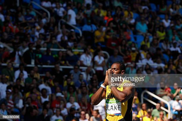 TOPSHOT Jamaica's Yohan Blake reacts during the Men's 200m Round 1 during the athletics competition at the Rio 2016 Olympic Games at the Olympic...