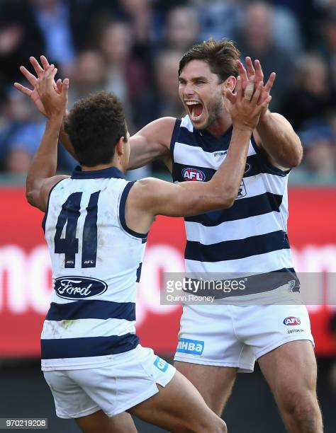 Jamaine Jones and Tom Hawkins of the Cats celebrate a goal during the round 12 AFL match between the Geelong Cats and the North Melbourne Kangaroos...
